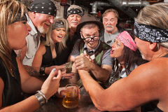Nerd Wins Arm Wrestling Match Stock Photo