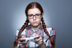 Nerd Woman with Gamepad. Nerd Woman with Braid Playing Videogames with a Joypad Stock Photos