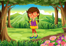 A nerd young lady at the forest Royalty Free Stock Photos