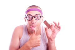Nerd with yummy chocolate Royalty Free Stock Images