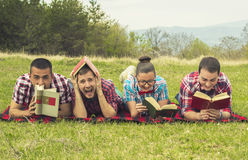 Nerds read in park Royalty Free Stock Photography