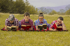 Nerds read in park Royalty Free Stock Photos