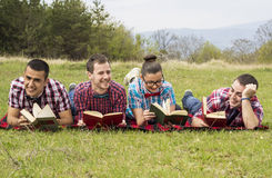Nerds read in park Royalty Free Stock Images