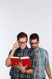 Nerds reading Royalty Free Stock Images