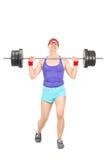 Nerdy Athlet, der versucht, ein Gewicht anzuheben Lizenzfreies Stockbild