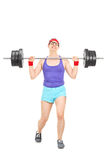 Nerdy athlete attempting to lift a weight Royalty Free Stock Image