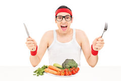 Nerdy athlete eating vegetables Stock Image