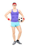 Nerdy athlete holding a football Stock Photography