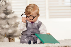 Nerdy bay boy reading a book. Nerdy bay boy with glasses reading a book Stock Photography