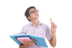 Nerdy boy with books Stock Images