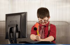 Nerdy boy smashing his computer Royalty Free Stock Photo