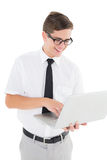 Nerdy businessman holding his laptop Stock Photos