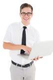 Nerdy businessman holding his laptop Stock Photos