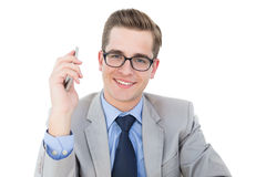 Nerdy businessman holding his smartphone Royalty Free Stock Photo