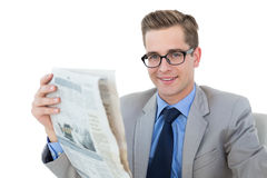 Nerdy businessman reading the newspaper Stock Photo
