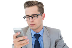 Nerdy businessman sending a text Royalty Free Stock Photos