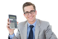 Nerdy businessman showing his calculator Royalty Free Stock Image