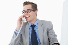 Nerdy businessman talking on phone Royalty Free Stock Photography