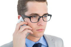 Nerdy businessman talking on phone Royalty Free Stock Photo