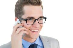 Nerdy businessman talking on phone Royalty Free Stock Photos