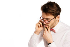 Nerdy businessman talking on a smartphone Royalty Free Stock Photography