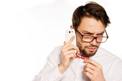 Nerdy businessman talking on a smartphone Royalty Free Stock Photos