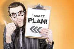 Nerdy businessman with target plan clipboard Stock Images