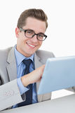 Nerdy businessman working on tablet pc Stock Images