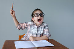 Nerdy child have an idea Stock Photography