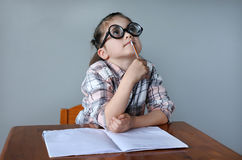 Nerdy child search for inspiration Royalty Free Stock Image