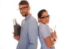 Nerdy couple holding files in a white background Royalty Free Stock Photos