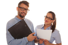 Nerdy couple holding files in a white background Royalty Free Stock Photo