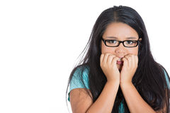 A nerdy female student in stress biting her nails Stock Image