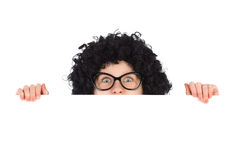 Nerdy girl behind white placard Royalty Free Stock Photos