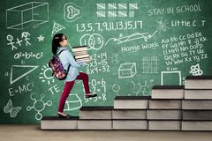 Nerdy girl with books and doodles Stock Images