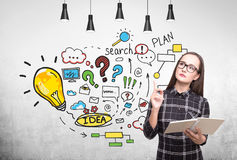 Nerdy girl and business plan Royalty Free Stock Photography