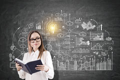 Nerdy girl and business scheme Stock Images