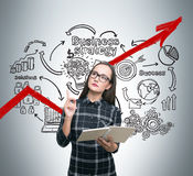 Nerdy girl and business strategy, red graph Stock Photography