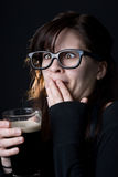 Nerdy girl drinking a beer Stock Images