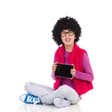 Nerdy girl got a new digital tablet royalty free stock photo