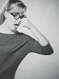 Nerdy girl holding nose. Stock Images