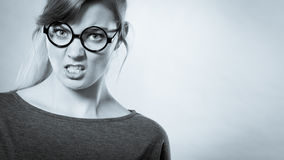 Nerdy girl pissed off. Stock Image