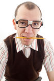 Nerdy guy biting pencil royalty free stock photography