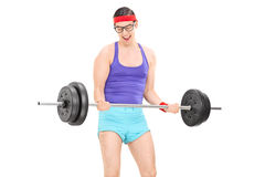 Nerdy guy exercising with a weight Stock Photography