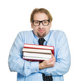 Nerdy guy holding books Stock Photo
