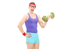 Nerdy guy holding a broccoli dumbbell Royalty Free Stock Photo