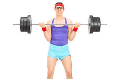 Nerdy guy lifting a heavy weight Royalty Free Stock Photos