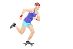 Nerdy guy riding a small skateboard Stock Images