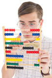 Nerdy hipster adding on abacus Stock Photo