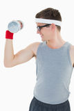 Nerdy hipster lifting heavy dumbbell Royalty Free Stock Photos